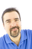 Man with a positive smile. Positively smiling man with gotee and blue shirt Royalty Free Stock Images