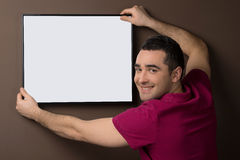 Man with poster. Stock Images