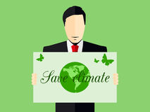 A man with a poster save the climate. Environmentalist. Royalty Free Stock Image