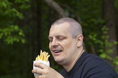 Man with potato chips in the hands of Stock Photography