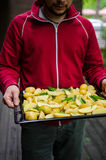 Man with potatoes Stock Photo