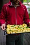 Man with potatoes Stock Photo