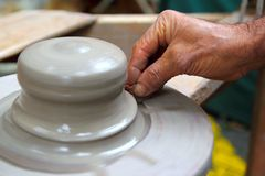Man potter hands working on pottery clay wheel Royalty Free Stock Photos