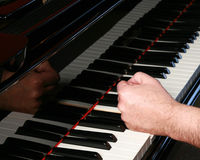 Man pounding fist on piano Stock Photo
