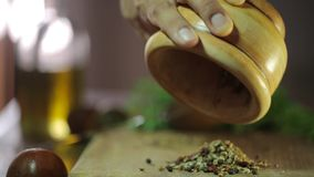 Man pounding spices in a mortar stock video footage