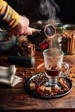 Man Pour Coffee in Mug. Royalty Free Stock Photo