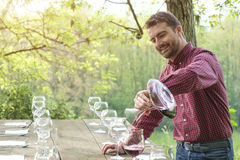 Man pour red wine Royalty Free Stock Photos