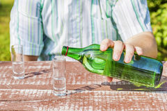 Man poured glass of alcohol Royalty Free Stock Photo