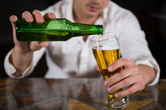 Man pouring beer in glass Stock Photography