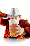 A man pouring beer into pint Royalty Free Stock Photo
