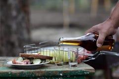 Man pouring brandy Royalty Free Stock Image