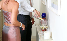Man pouring Champagne at a dinner party Royalty Free Stock Photos
