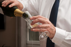 Man pouring champagne into a glass Royalty Free Stock Images