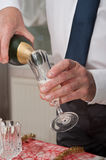Man pouring champagne into a glass Stock Photos