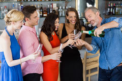 Man pouring champagne into glass Royalty Free Stock Photos