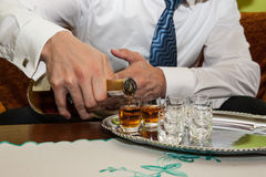 Man is pouring cognac Royalty Free Stock Photo