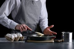 Man pouring dough for pie. cake making concept stock image