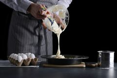 Man pouring dough for pie. cake making concept royalty free stock photos