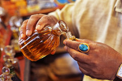 Man pouring essential oil. From glass bottle royalty free stock images