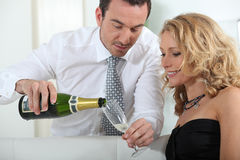Man pouring glass of champagne Stock Photos