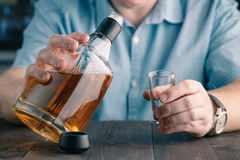 Man Pouring Himself a Drink Royalty Free Stock Photography