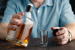Man Pouring Himself a Drink Royalty Free Stock Image