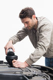 Man pouring oil into engine Royalty Free Stock Photo