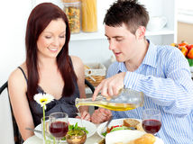 Man pouring oil in his girlfriend's salad Royalty Free Stock Images