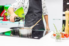 Man pouring in the pan royalty free stock images
