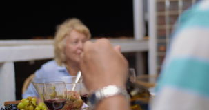 Man pouring red wine during the dinner stock footage
