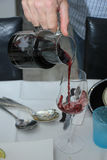 Man pouring red wine Stock Photography