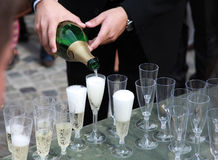 Man pouring sparkling bubbly champagne Stock Photography