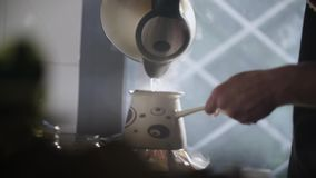 Man Pouring Steaming Hot Water In A Turkish Coffee Pot 2. Man Pouring Steaming Hot Water In A Turkish Coffee Pot stock video footage