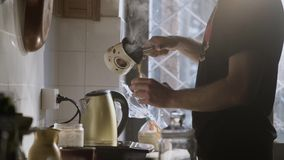 Man Pouring Hot Water In A Turkish Coffee Pot 4. Man Pouring Steaming Hot Water In A Turkish Coffee Pot stock footage