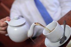 Man pouring tea Stock Photo