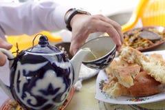 Man pouring tea into cup Stock Photos