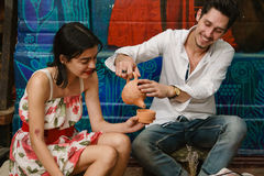 A man is pouring tea into a girl's cup Royalty Free Stock Photo