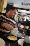 Man pouring tea Royalty Free Stock Photos