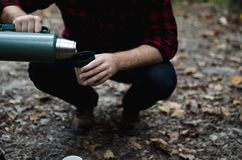 Man pouring from thermos Stock Photo