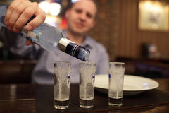 Man pouring vodka Royalty Free Stock Images