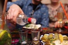 Man pouring vodka Stock Photo