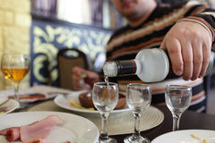 Man pouring vodka in restaurant Royalty Free Stock Photos