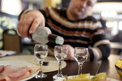 Man pouring vodka in pub Stock Photography