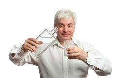 Man, pouring vodka into the glass Stock Image
