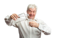 Man, pouring vodka into the glass Royalty Free Stock Photo