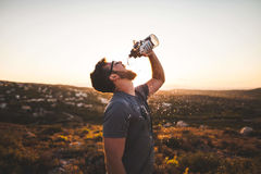 Man Pouring Water Bottle on His Mouth Stock Photos