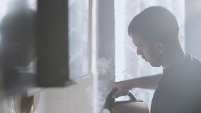 Man Pouring Water From Electric Hot Water Tea Kettle Pot stock footage