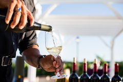 Man pouring white wine  Royalty Free Stock Images