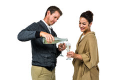Man pouring wine in glass with smiling woman Royalty Free Stock Photos