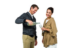 Man pouring wine in glass with woman Stock Photography